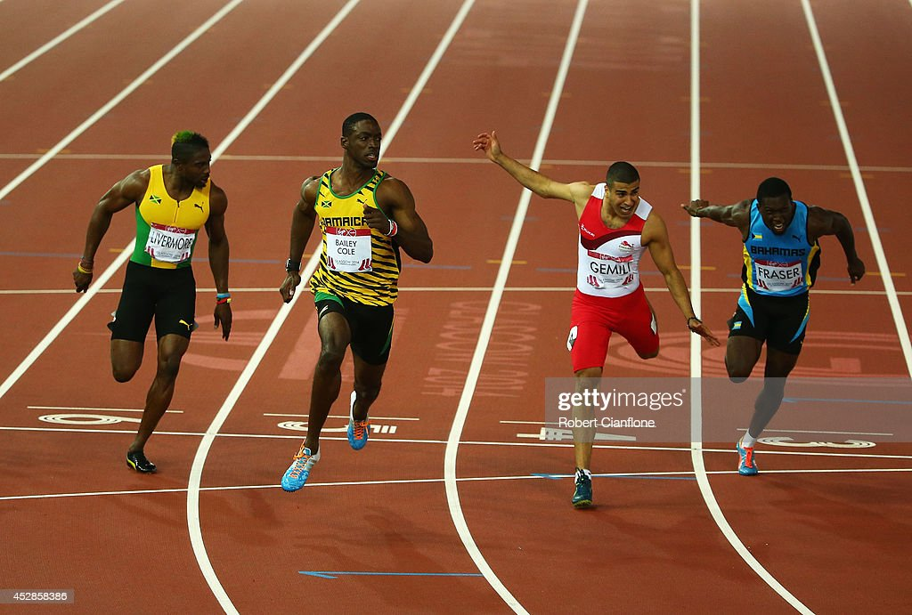 Kemar BaileyCole of Jamaica crosses the line to win gold ahead of silver medalist Adam Gemili of England in the Men's 100 metres final at Hampden...