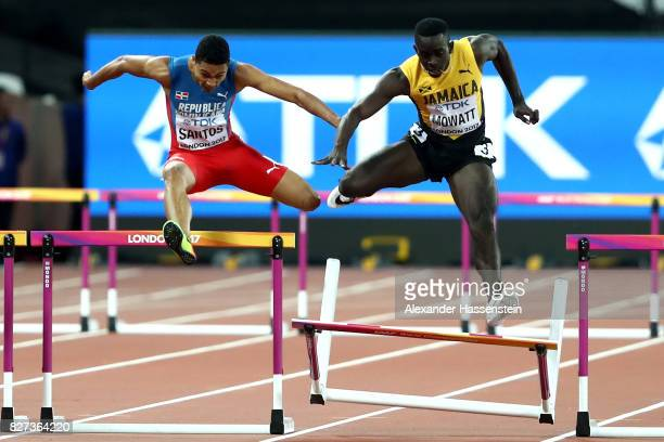 Kemar Mowatt of the Jamaica hits a hurdle along side Juander Santos of Dominica Republic as they compete in the Men's 400 metres hurdles semi finals...