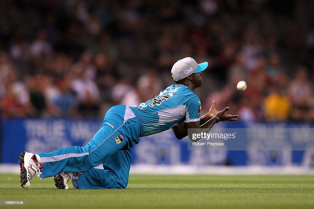 <a gi-track='captionPersonalityLinkClicked' href=/galleries/search?phrase=Kemar+Roach&family=editorial&specificpeople=5408487 ng-click='$event.stopPropagation()'>Kemar Roach</a> of the Heat takes a catch to dismiss Aaron Finch of the Renegades off the bowling of James Hopes of the Heat during the Big Bash League match between the Melbourne Renegades and the Brisbane Heat at Etihad Stadium on December 22, 2012 in Melbourne, Australia.