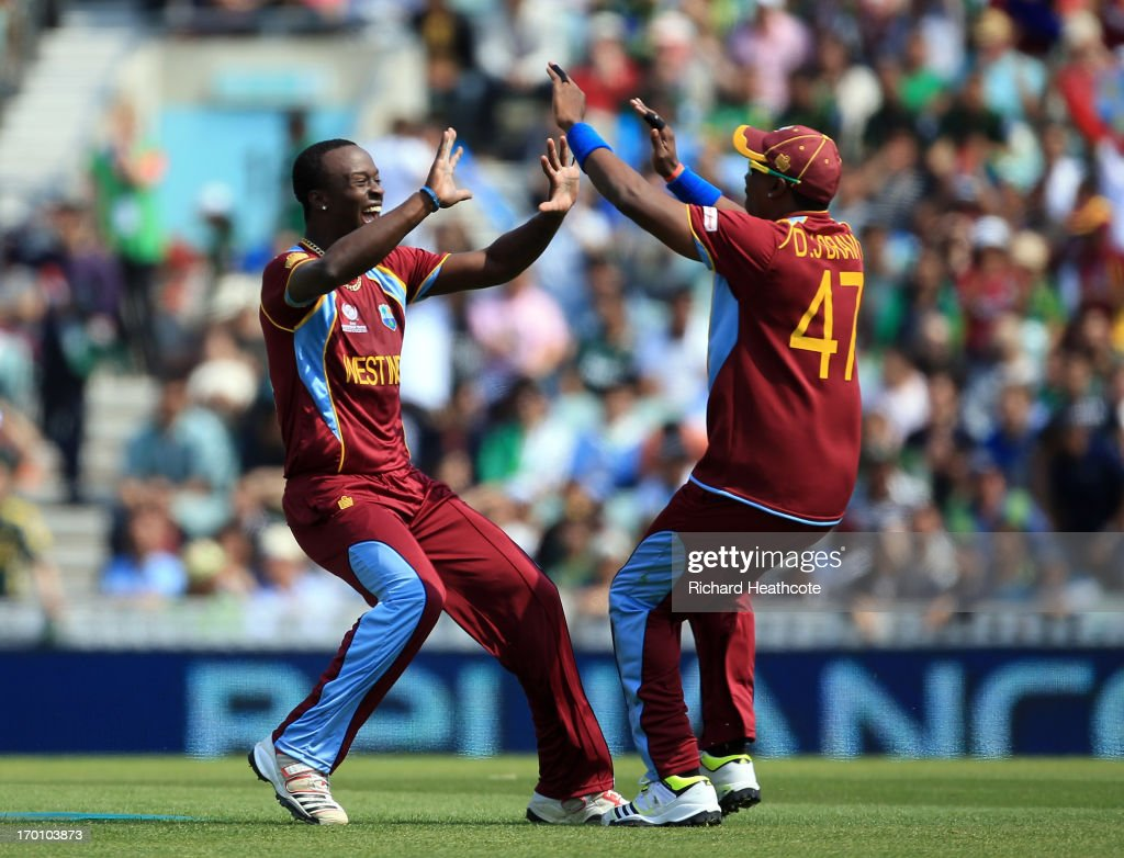 <a gi-track='captionPersonalityLinkClicked' href=/galleries/search?phrase=Kemar+Roach&family=editorial&specificpeople=5408487 ng-click='$event.stopPropagation()'>Kemar Roach</a> of the West Indies celebrates taking the wicket of Asad Shafiq of Pakistan during the ICC Champions Trophy group B match between West Indies and Pakistan at The Oval on June 7, 2013 in London, England.