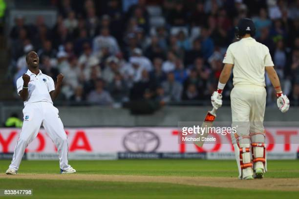 Kemar Roach of West Indies celebrates bowling Joe Root of England during day one of the 1st Investec Test match between England and West Indies at...