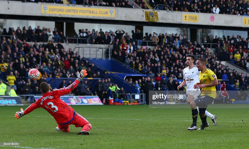 Kemar Roofe of Oxford United shoots past goalkeeper Kristoffer Nordfeldt of Swansea City to score his team's third goal during The Emirates FA Cup third round match between Oxford United and Swansea City at the Kassam Stadium on January 10, 2016 in Oxford, England.