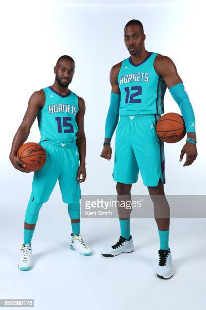 Kemba Walker and Dwight Howard of the Charlotte Hornets pose for a portrait during media day on September 25 2017 at Spectrum Center in Charlotte...
