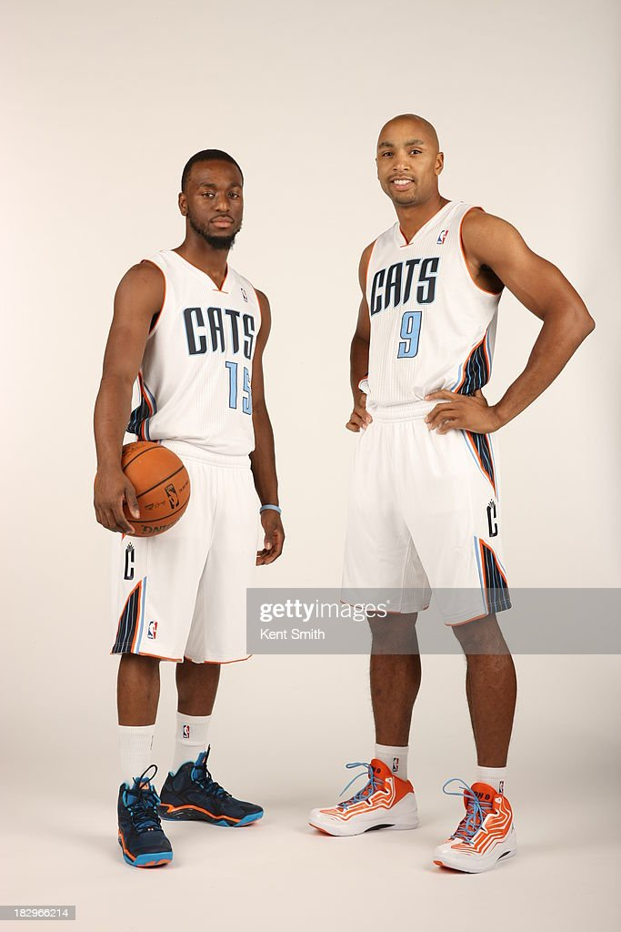 Kemba Walker #15 and Gerald Henderson #9 of the Charlotte Bobcats pose for a portrait on media day at the Time Warner Cable Arena on September 30, 2013 in Charlotte, North Carolina.