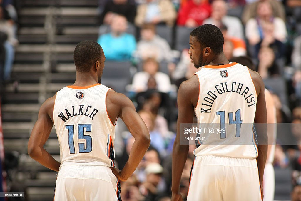 Kemba Walker #15 and Michael Kidd-Gilchrist #14 of the Charlotte Bobcats confer during the game against the Oklahoma City Thunder at the Time Warner Cable Arena on March 8, 2013 in Charlotte, North Carolina.
