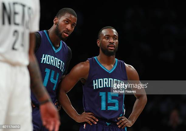 Kemba Walker and Michael KiddGilchrist of the Charlotte Hornets look on against the Brooklyn Nets during the second half at Barclays Center on...