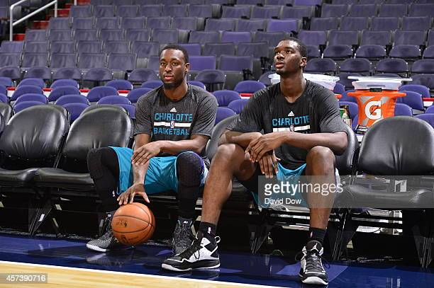 Kemba Walker and Noah Vonleh of the Charlotte Hornets talk before a game against the Washington Wizards at the Verizon Center on October 17 2014 in...