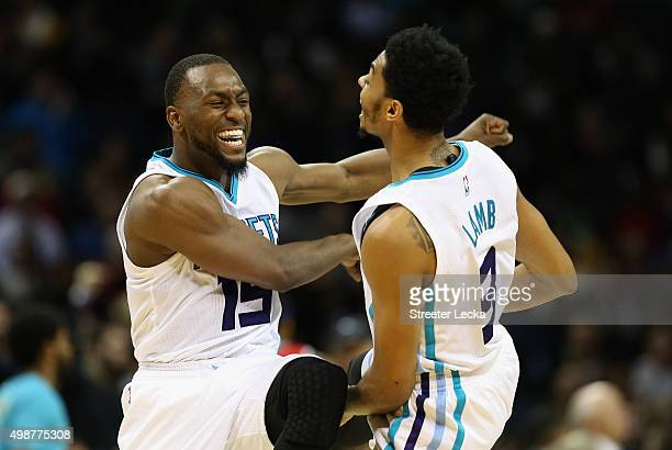 Kemba Walker and teammate Jeremy Lamb of the Charlotte Hornets react after a play during their game against the Washington Wizards at Time Warner...
