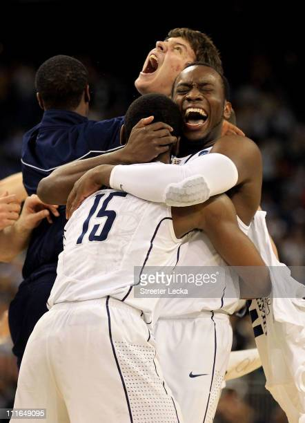 Kemba Walker Donnell Beverly and Tyler Olander of the Connecticut Huskies react after defeating the Butler Bulldogs to win the National Championship...