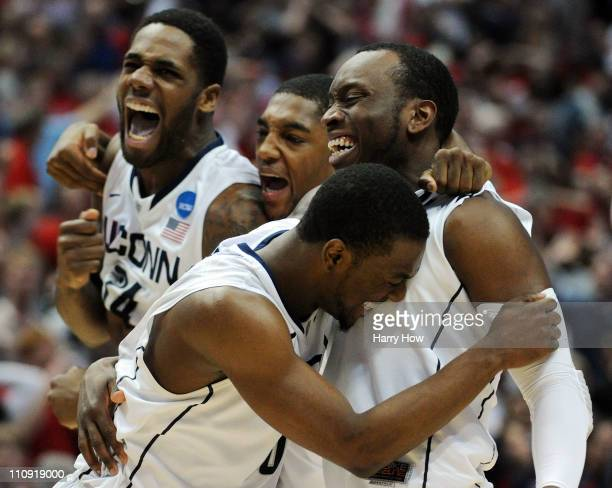 Kemba Walker Donnell Beverly Roscoe Smith and Alex Oriakhi of the Connecticut Huskies celebrate after defeating the Arizona Wildcats during the west...
