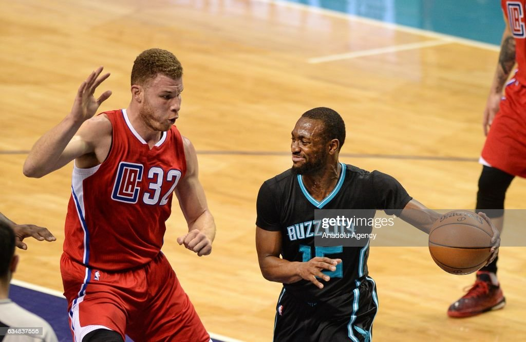 Kemba Walker of Charlotte Hornets protects the ball from Blake Griffin of L.A. Clippers during the NBA match between Los Angeles Clippers vs Charlotte Hornets at the Spectrum arena in Charlotte, NC, USA on February 11, 2017.