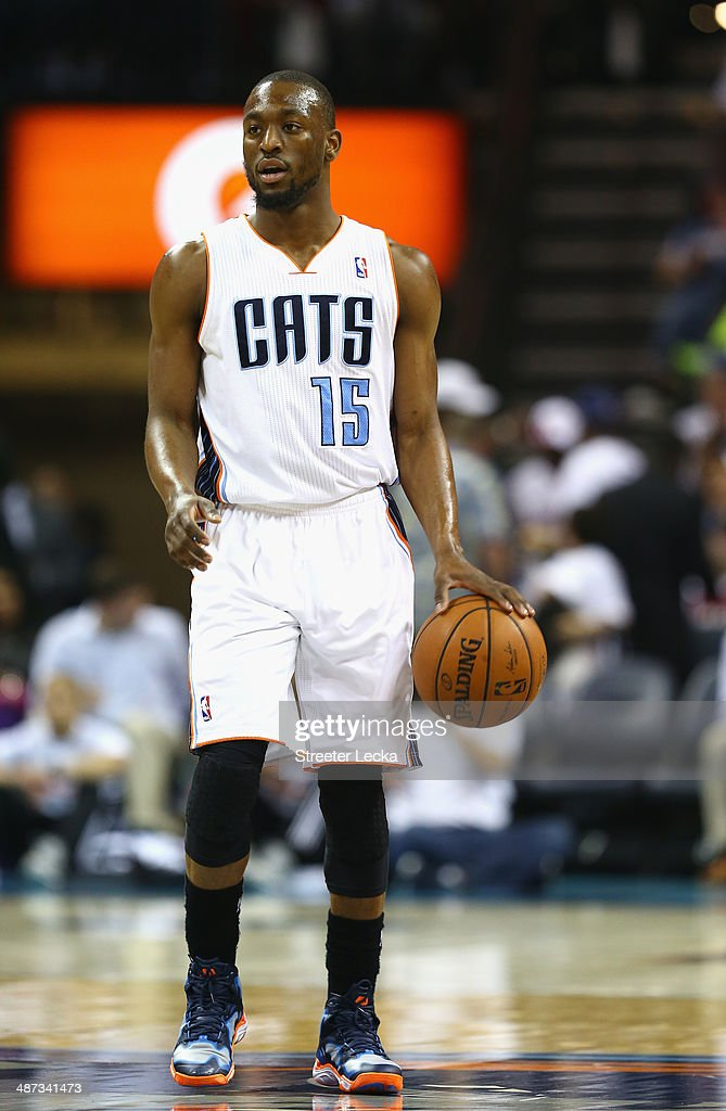 Kemba Walker #15 of the Charlotte Bobcats against the Miami Heat in Game Four of the Eastern Conference Quarterfinals during the 2014 NBA Playoffs at Time Warner Cable Arena on April 28, 2014 in Charlotte, North Carolina.