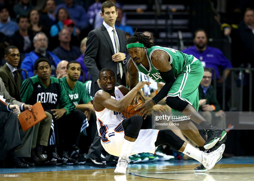 Kemba Walker #15 of the Charlotte Bobcats and Gerald Wallace #45 of the Boston Celtics fight for a loose ball during their game at Time Warner Cable Arena on November 25, 2013 in Charlotte, North Carolina.