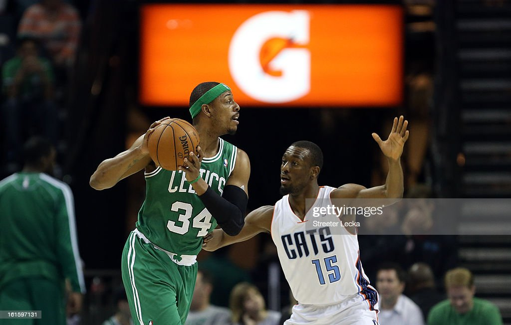 Kemba Walker #15 of the Charlotte Bobcats and Paul Pierce #34 of the Boston Celtics during their game at Time Warner Cable Arena on February 11, 2013 in Charlotte, North Carolina.