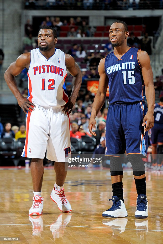 Kemba Walker #15 of the Charlotte Bobcats and Will Bynum #12 of the Detroit Pistons wait to resume action during their game on January 6, 2013 at The Palace of Auburn Hills in Auburn Hills, Michigan.