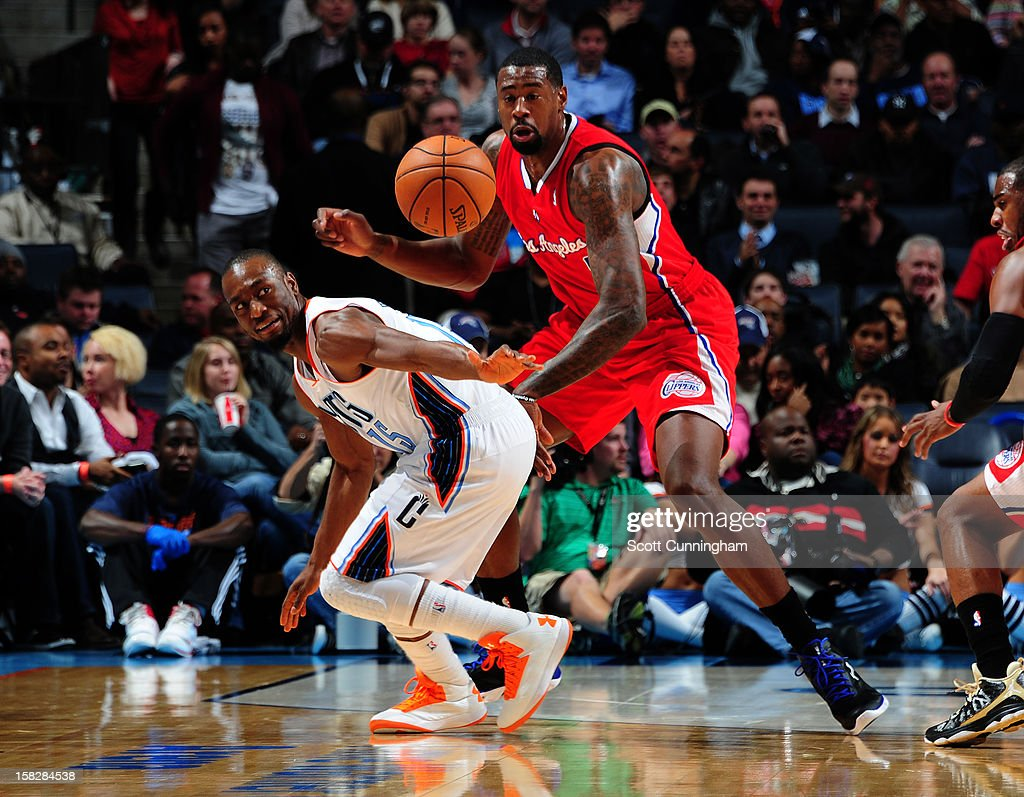 Kemba Walker #15 of the Charlotte Bobcats battles for a loose ball against DeAndre Jordan #6 of the Los Angeles Clippers at Time Warner Cable Arena on December 12, 2012 in Charlotte, North Carolina.