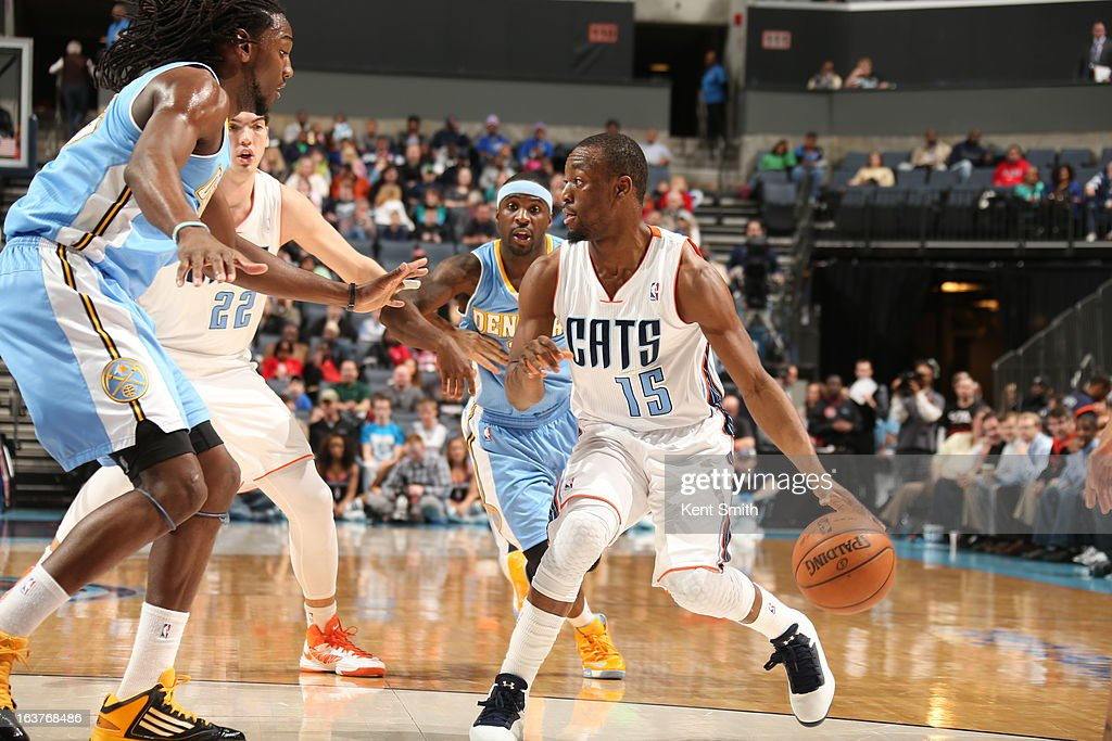 <a gi-track='captionPersonalityLinkClicked' href=/galleries/search?phrase=Kemba+Walker&family=editorial&specificpeople=5042442 ng-click='$event.stopPropagation()'>Kemba Walker</a> #15 of the Charlotte Bobcats brings the ball up court against the Denver Nuggets at the Time Warner Cable Arena on February 23, 2013 in Charlotte, North Carolina.