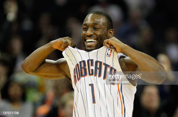 Kemba Walker of the Charlotte Bobcats celebrates after a basket against the Golden State Warriors during their game at Time Warner Cable Arena on...