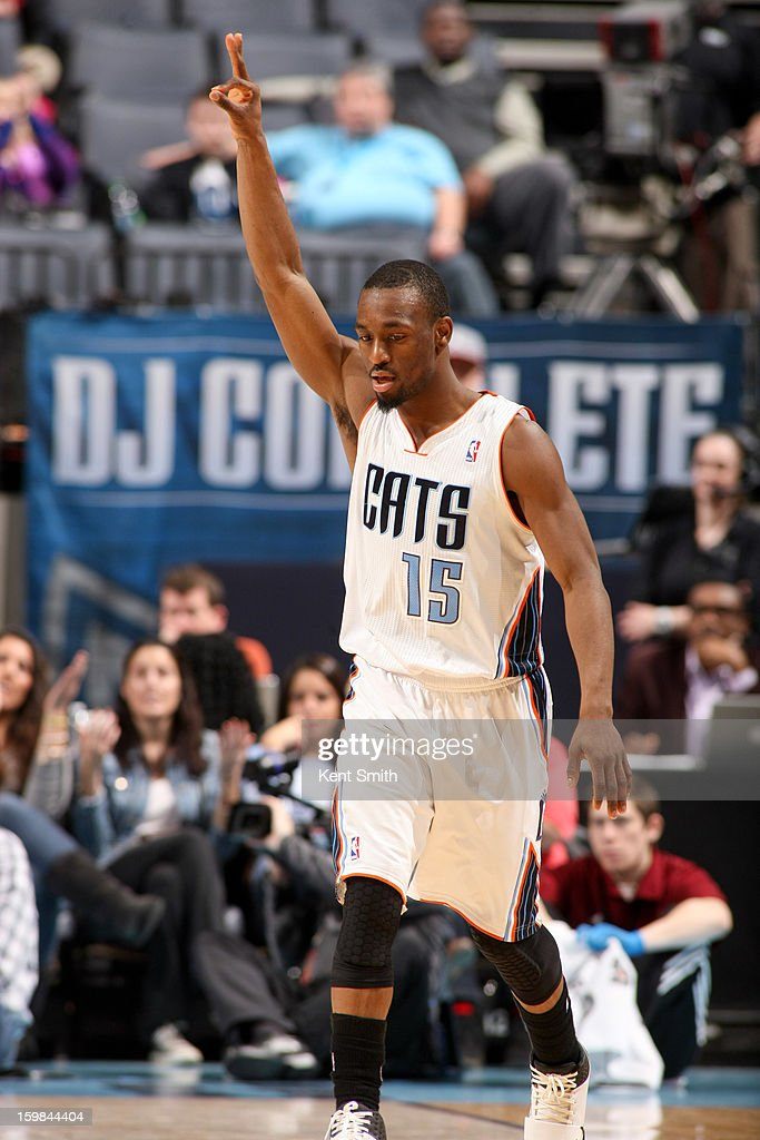 Kemba Walker #15 of the Charlotte Bobcats celebrates after making a three-pointer against the Houston Rockets at the Time Warner Cable Arena on January 21, 2013 in Charlotte, North Carolina.
