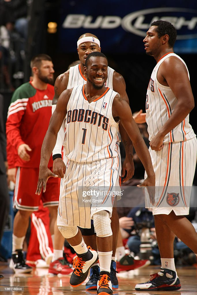 <a gi-track='captionPersonalityLinkClicked' href=/galleries/search?phrase=Kemba+Walker&family=editorial&specificpeople=5042442 ng-click='$event.stopPropagation()'>Kemba Walker</a> #1 of the Charlotte Bobcats celebrates on December 26, 2011 during the season opener against the Milwaukee Bucks at the Time Warner Cable Arena in Charlotte, North Carolina.