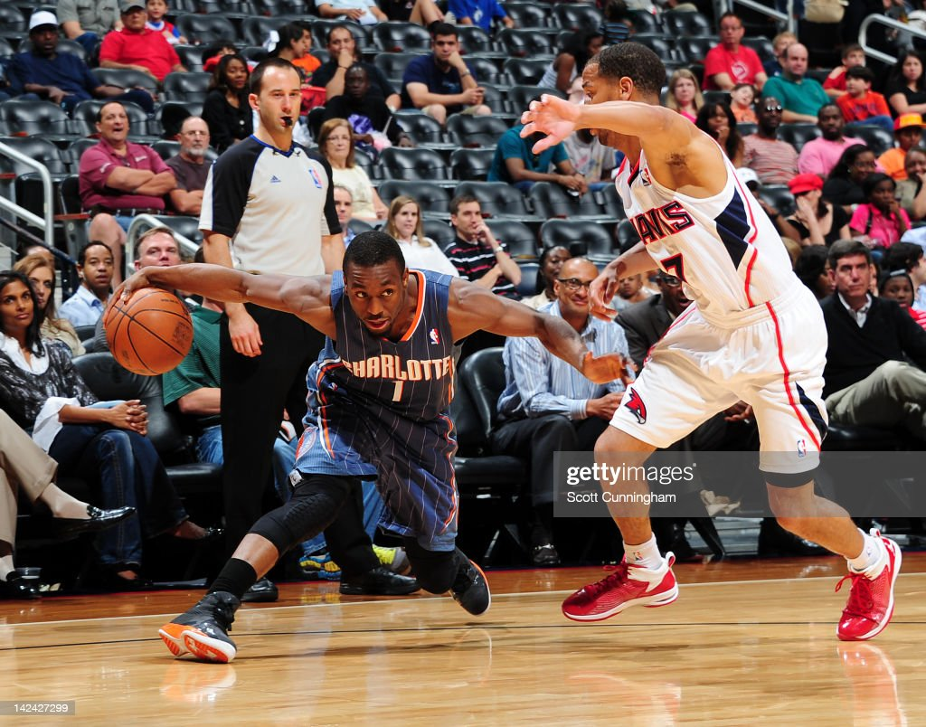 <a gi-track='captionPersonalityLinkClicked' href=/galleries/search?phrase=Kemba+Walker&family=editorial&specificpeople=5042442 ng-click='$event.stopPropagation()'>Kemba Walker</a> #1 of the Charlotte Bobcats controls the ball against <a gi-track='captionPersonalityLinkClicked' href=/galleries/search?phrase=Jannero+Pargo&family=editorial&specificpeople=206618 ng-click='$event.stopPropagation()'>Jannero Pargo</a> #7 of the Atlanta Hawks on April 4, 2012 at Philips Arena in Atlanta, Georgia.