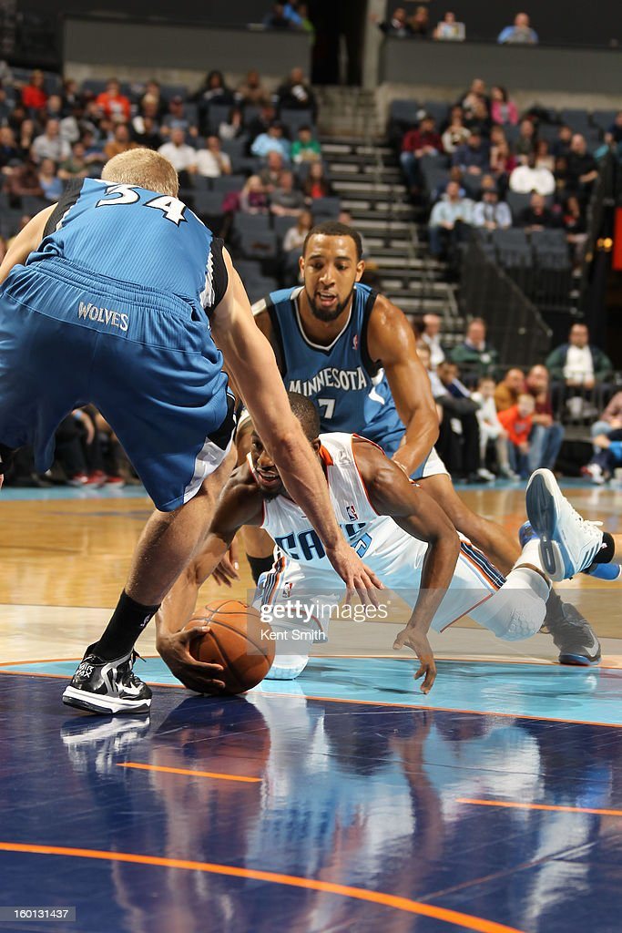 Kemba Walker #15 of the Charlotte Bobcats dives for the ball against Greg Stiemsma #34 of the Minnesota Timberwolves at the Time Warner Cable Arena on January 26, 2013 in Charlotte, North Carolina.