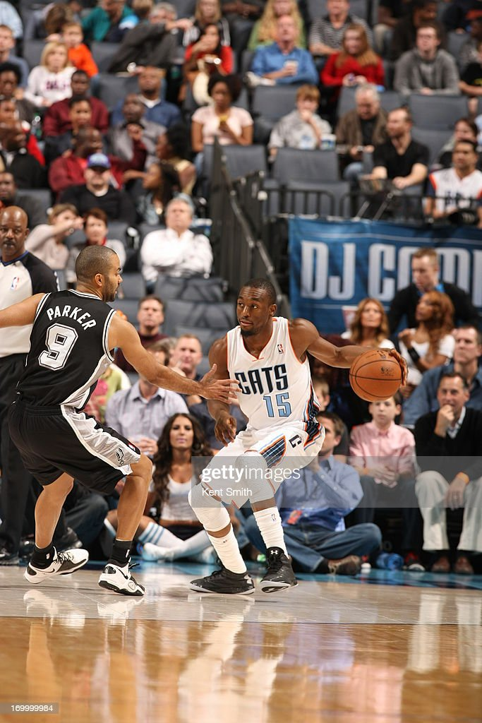 Kemba Walker #15 of the Charlotte Bobcats dribbles the ball against the San Antonio Spurs at the Time Warner Cable Arena on December 8, 2012 in Charlotte, North Carolina.