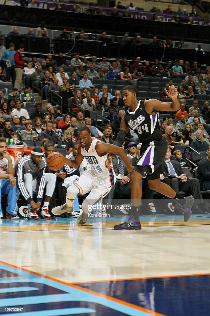 Kemba Walker #15 of the Charlotte Bobcats drives against Jason Thompson #34 of the Sacramento Kings at the Time Warner Cable Arena on January 19, 2013 in Charlotte, North Carolina.