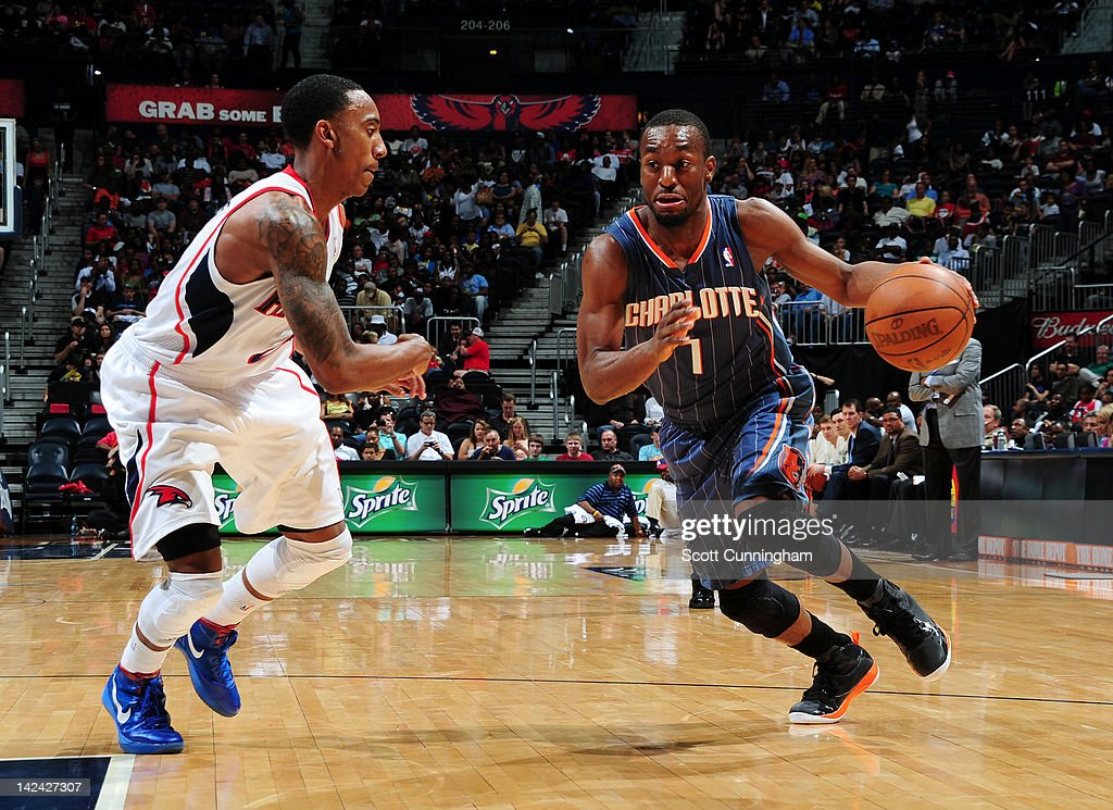 <a gi-track='captionPersonalityLinkClicked' href=/galleries/search?phrase=Kemba+Walker&family=editorial&specificpeople=5042442 ng-click='$event.stopPropagation()'>Kemba Walker</a> #1 of the Charlotte Bobcats drives against <a gi-track='captionPersonalityLinkClicked' href=/galleries/search?phrase=Jeff+Teague&family=editorial&specificpeople=4680498 ng-click='$event.stopPropagation()'>Jeff Teague</a> #0 of the Atlanta Hawks on April 4, 2012 at Philips Arena in Atlanta, Georgia.