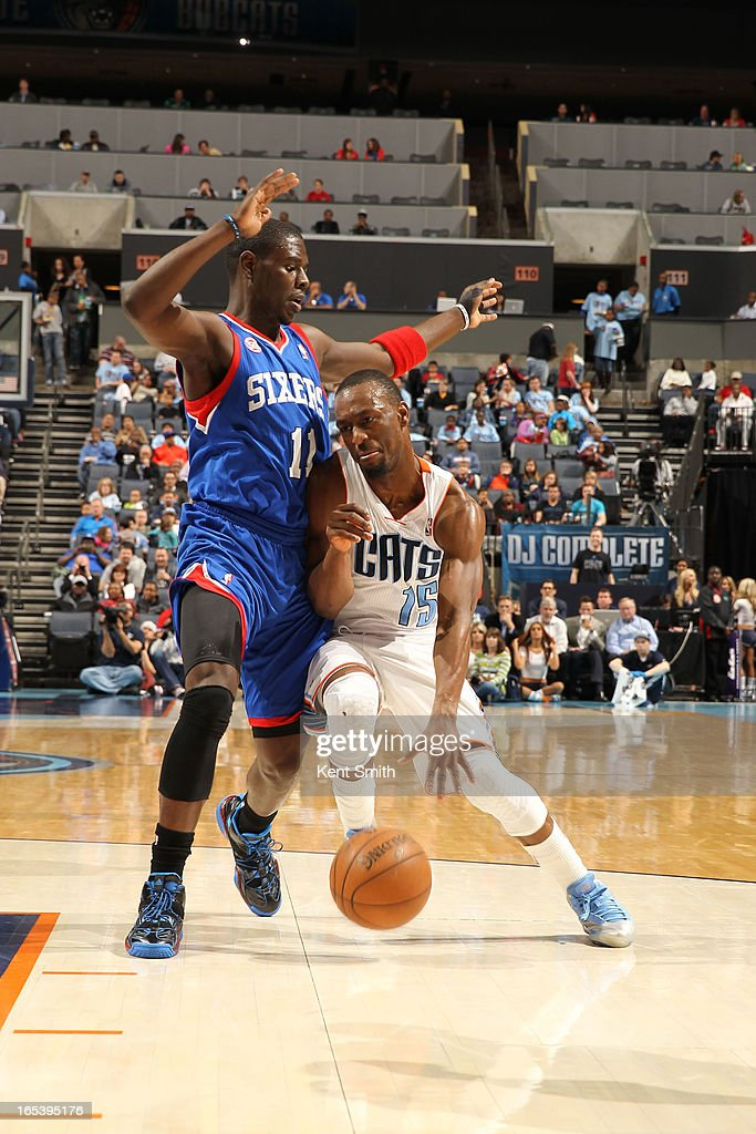 Kemba Walker #15 of the Charlotte Bobcats drives against Jrue Holiday #11 of the Philadelphia 76ers at the Time Warner Cable Arena on April 3, 2013 in Charlotte, North Carolina.