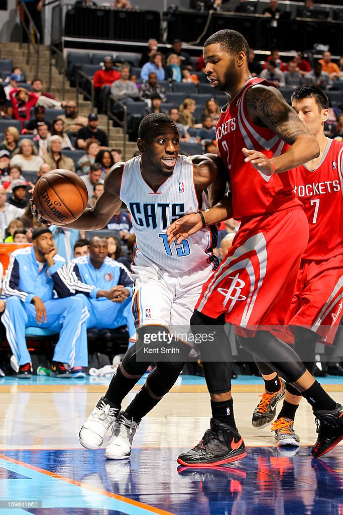 Kemba Walker #15 of the Charlotte Bobcats drives against Marcus Morris #2 of the Houston Rockets at the Time Warner Cable Arena on January 21, 2013 in Charlotte, North Carolina.
