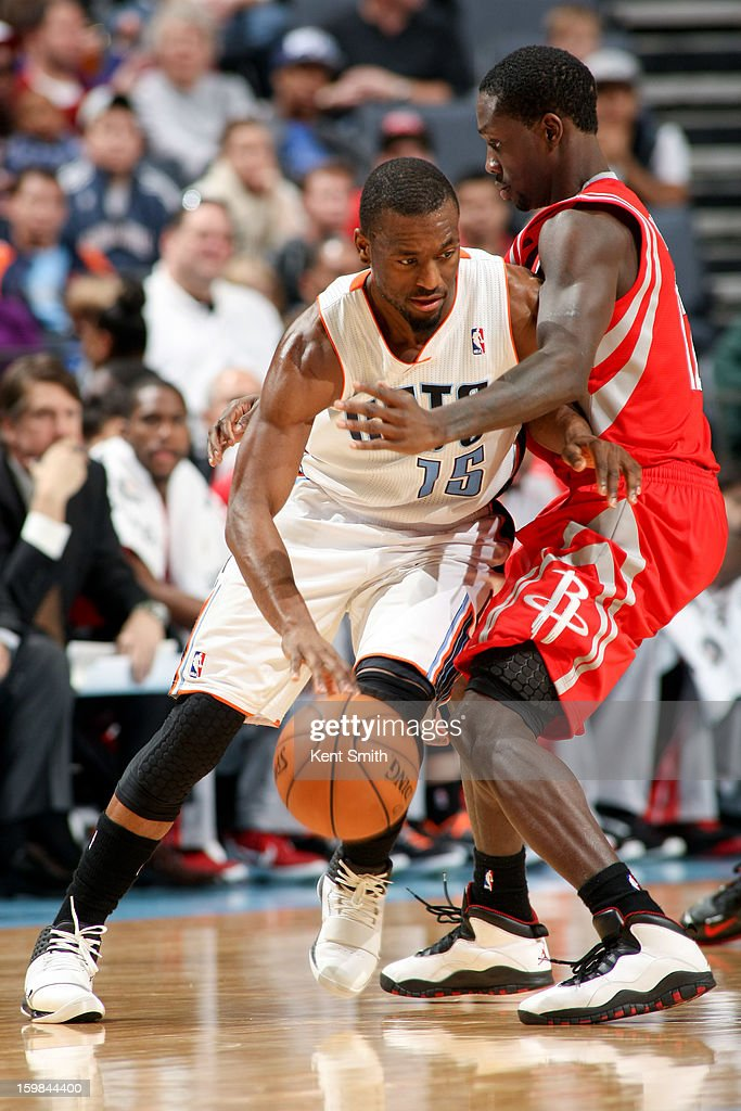 Kemba Walker #15 of the Charlotte Bobcats drives against Patrick Beverley #12 of the Houston Rockets at the Time Warner Cable Arena on January 21, 2013 in Charlotte, North Carolina.