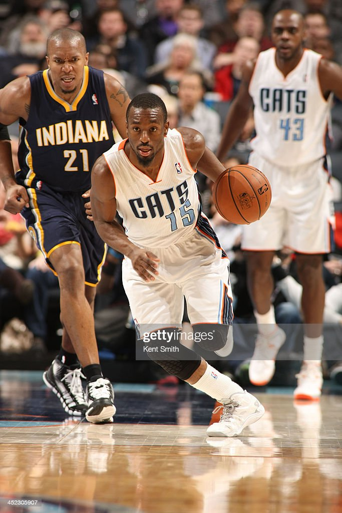 <a gi-track='captionPersonalityLinkClicked' href=/galleries/search?phrase=Kemba+Walker&family=editorial&specificpeople=5042442 ng-click='$event.stopPropagation()'>Kemba Walker</a> #15 of the Charlotte Bobcats drives against the Indiana Pacers during the game at the Time Warner Cable Arena on November 27, 2013 in Charlotte, North Carolina.