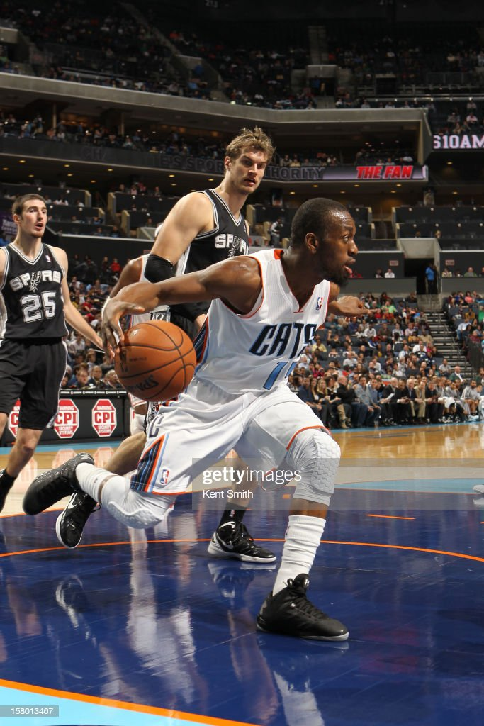 Kemba Walker #15 of the Charlotte Bobcats drives against the San Antonio Spurs at the Time Warner Cable Arena on December 8, 2012 in Charlotte, North Carolina.