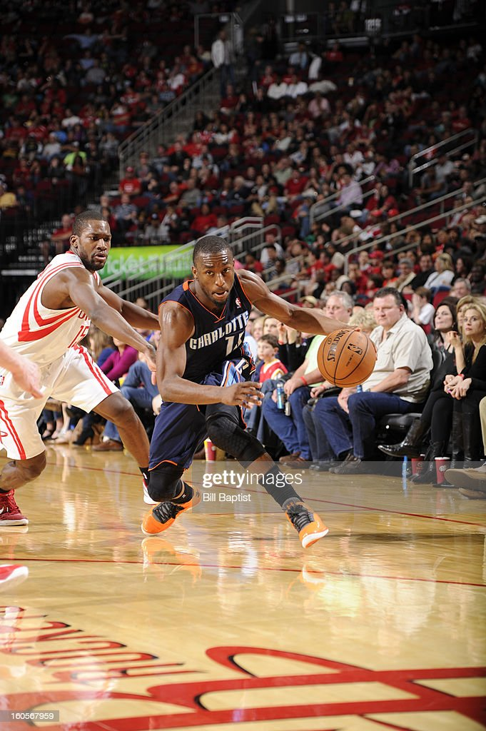 Kemba Walker #15 of the Charlotte Bobcats drives against Toney Douglas #15 of the Houston Rockets on February 2, 2013 at the Toyota Center in Houston, Texas.