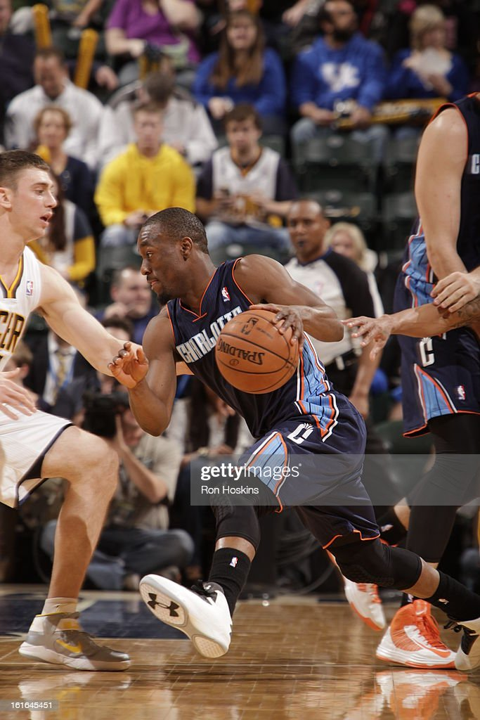 Kemba Walker #15 of the Charlotte Bobcats drives against Tyler Hansbrough #50 of the Indiana Pacers on February 13, 2013 at Bankers Life Fieldhouse in Indianapolis, Indiana.