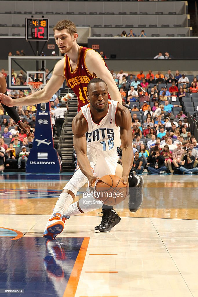 Kemba Walker #15 of the Charlotte Bobcats drives against Tyler Zeller #40 of the Cleveland Cavaliers at the Time Warner Cable Arena on April 17, 2013 in Charlotte, North Carolina.