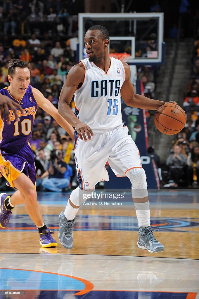 Kemba Walker #15 of the Charlotte Bobcats drives past Steve Nash #10 of the Los Angeles Lakers on February 8, 2013 at the Time Warner Cable Arena in Charlotte, North Carolina.