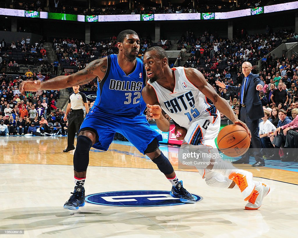 Kemba Walker #15 of the Charlotte Bobcats drives to the basket against O.J. Mayo #32 of the Dallas Mavericks at Time Warner Cable Arena on November 10, 2012 in Charlotte, North Carolina.