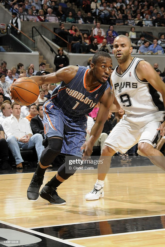 <a gi-track='captionPersonalityLinkClicked' href=/galleries/search?phrase=Kemba+Walker&family=editorial&specificpeople=5042442 ng-click='$event.stopPropagation()'>Kemba Walker</a> #1 of the Charlotte Bobcats drives to the basket against Tony Parker #9 of the San Antonio Spurs during the game at the AT&T Center on March 2, 2012 in San Antonio, Texas.