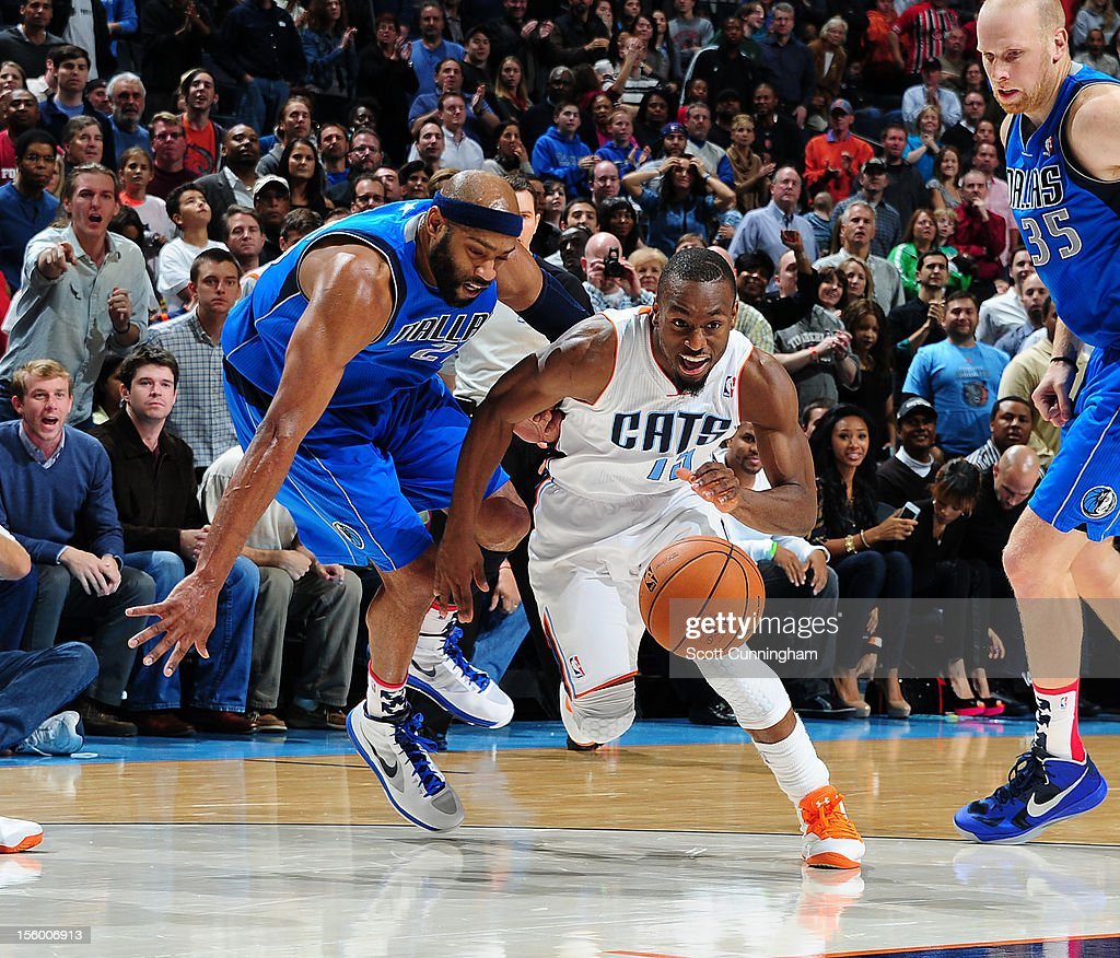 Kemba Walker #15 of the Charlotte Bobcats drives to the basket against the Dallas Mavericks at Time Warner Cable Arena on November 10, 2012 in Charlotte, North Carolina.