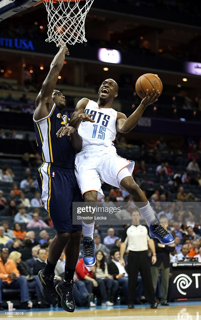Kemba Walker #15 of the Charlotte Bobcats drives to the basket against Paul Millsap #24 of the Utah Jazz during their game at Time Warner Cable Arena on January 9, 2013 in Charlotte, North Carolina.