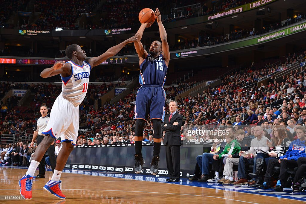 Kemba Walker #15 of the Charlotte Bobcats drives to the basket against Jrue Holiday #11 of the Philadelphia 76ers during the game at the Wells Fargo Center on February 9, 2013 in Philadelphia, Pennsylvania.