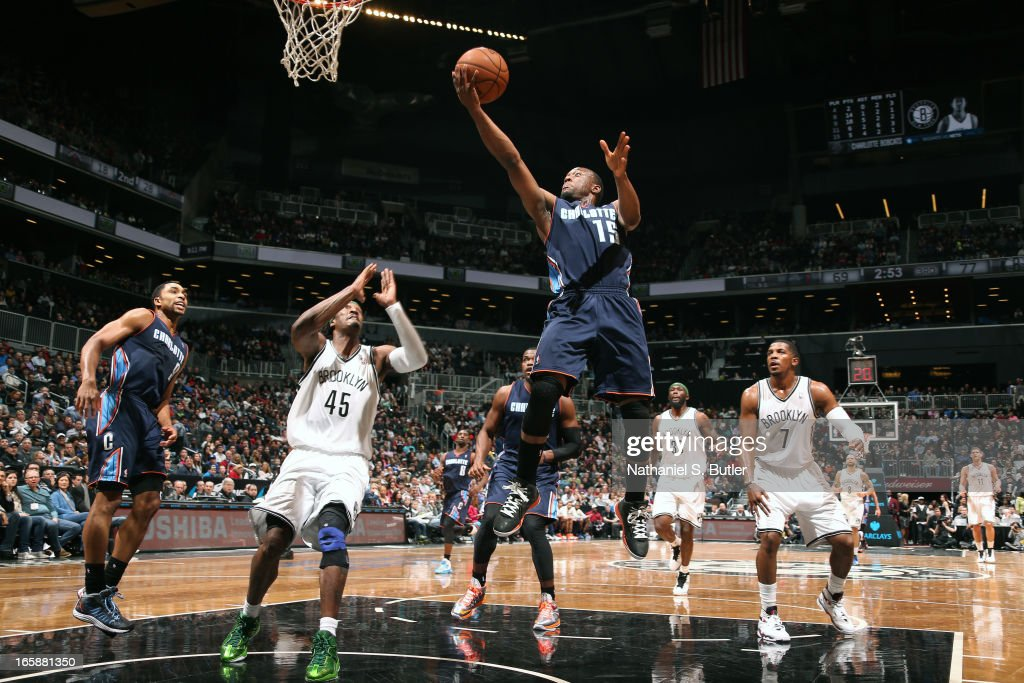 Kemba Walker #15 of the Charlotte Bobcats drives to the basket against Gerald Wallace #45 of the Brooklyn Nets on April 6, 2013 at the Barclays Center in the Brooklyn borough of New York City.