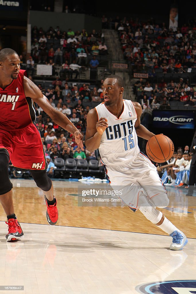 <a gi-track='captionPersonalityLinkClicked' href=/galleries/search?phrase=Kemba+Walker&family=editorial&specificpeople=5042442 ng-click='$event.stopPropagation()'>Kemba Walker</a> #15 of the Charlotte Bobcats drives to the basket against the Miami Heat at the Time Warner Cable Arena on April 5, 2013 in Charlotte, North Carolina.
