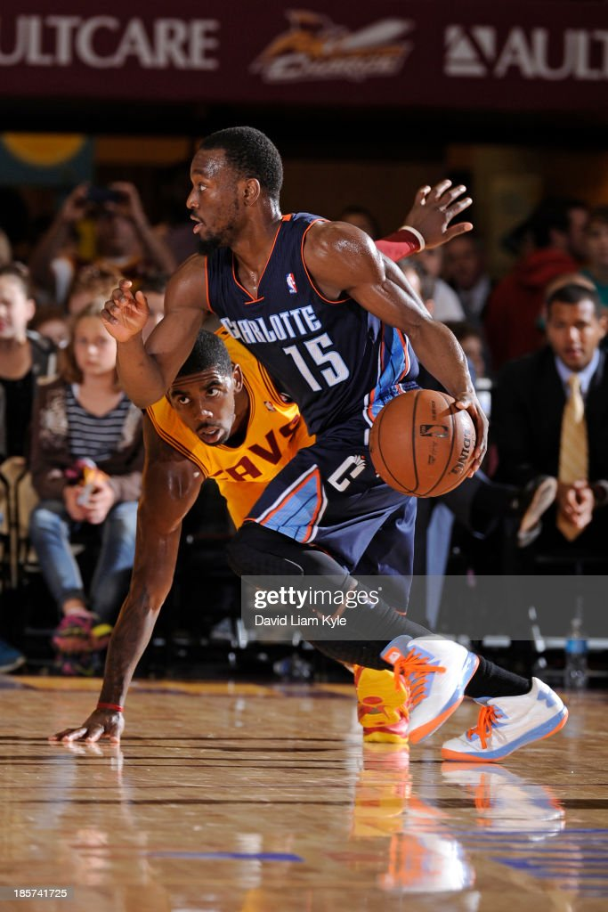 <a gi-track='captionPersonalityLinkClicked' href=/galleries/search?phrase=Kemba+Walker&family=editorial&specificpeople=5042442 ng-click='$event.stopPropagation()'>Kemba Walker</a> #15 of the Charlotte Bobcats drives to the basket against <a gi-track='captionPersonalityLinkClicked' href=/galleries/search?phrase=Kyrie+Irving&family=editorial&specificpeople=6893971 ng-click='$event.stopPropagation()'>Kyrie Irving</a> #2 of the Cleveland Cavaliers at the Canton Memorial Civic Center on October 15, 2013 in Canton, Ohio.