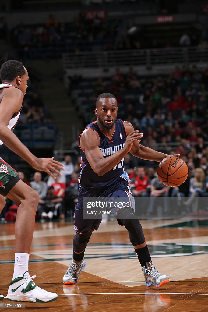 Kemba Walker #15 of the Charlotte Bobcats drives to the basket against the Milwaukee Bucks on March 16, 2014 at the BMO Harris Bradley Center in Milwaukee, Wisconsin.