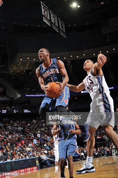 Kemba Walker of the Charlotte Bobcats drives to the basket past Gerald Green of the New Jersey Nets on March 24 2012 at the Prudential Center in...