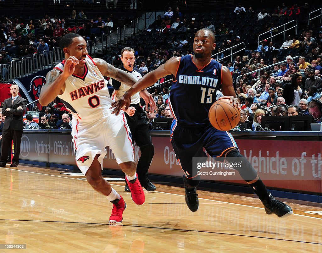 Kemba Walker #15 of the Charlotte Bobcats drives to the hoop against the Charlotte Bobcats at Philips Arena on December 13 ,2012 in Atlanta, Georgia.