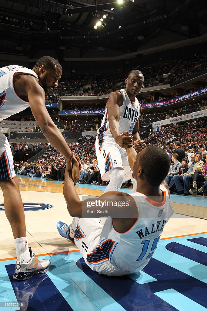Kemba Walker #15 of the Charlotte Bobcats gets a hand up from his teammates during the game against the Miami Heat at the Time Warner Cable Arena on April 5, 2013 in Charlotte, North Carolina.